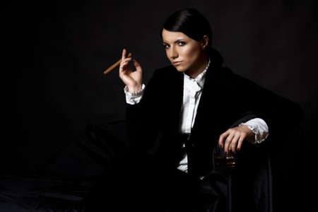 cigare: beautiful young woman with cigare and alcohol