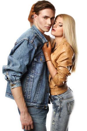 women kissing women: Sexy young couple wearing jeans in the studio