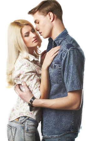 seductive expression: Sexy young couple wearing jeans in the studio