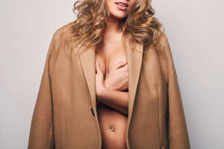 sexy nude women: Portrait of beautiful blond woman in mans coat