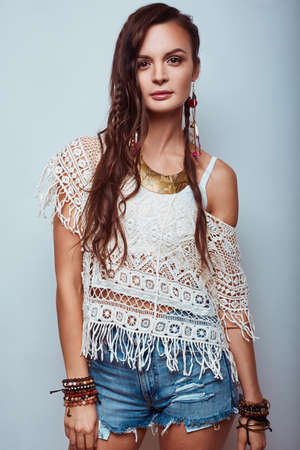 chic woman: Portrait of beautiful young hippie woman in studio