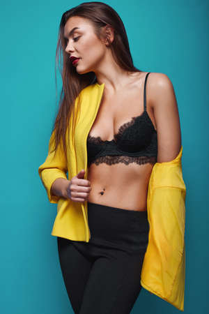 swag: Portrait of fashion glamor stylish swag young woman in yellow coat  on bright background