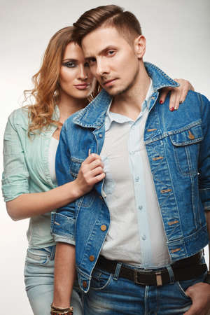 jeanswear: Portrait of fashion glamor stylish swag young couple wearing jeans in studio