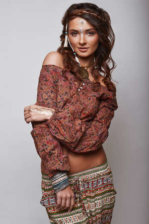 girl on a beautiful background: Portrait of beautiful glamor hipster young hippie woman in studio