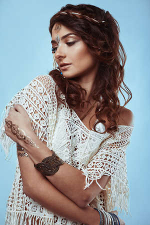 Portrait of beautiful glamor hipster young hippie woman in knitted shirt