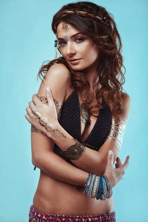 hippie woman: Portrait of beautiful glamor hipster young hippie woman in knitted bra Stock Photo