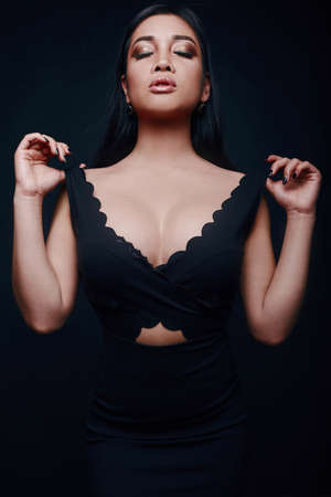 beauty girls: Fashion swag portrait of beautiful elegant asian woman in formal dress on black background Stock Photo