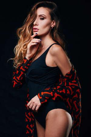 nude female body model: Studio portrait of a sexy senseual blonde in black body Stock Photo