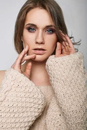 pullover: Portrait of beautiful blond woman in woolen sweater