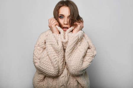 girl on a beautiful background: Portrait of beautiful blond woman in woolen sweater