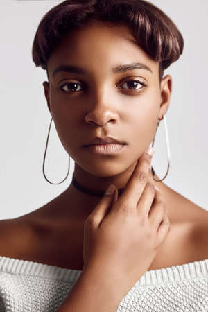 Close-up sensual portrait of young beautiful hipster black girl with short hair isolated on white background. Studio shoot. Foto de archivo