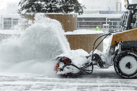 machine for snow removal cleans the road