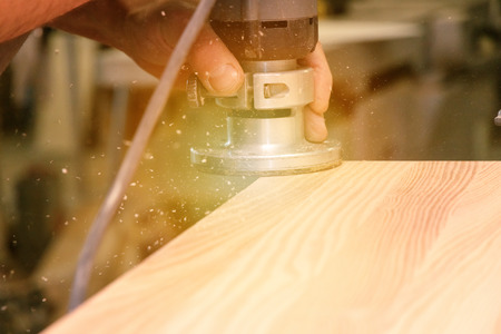 Processing of wooden boards hand cutter close-up Stok Fotoğraf