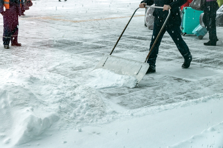 A man cleans the road from the snow.