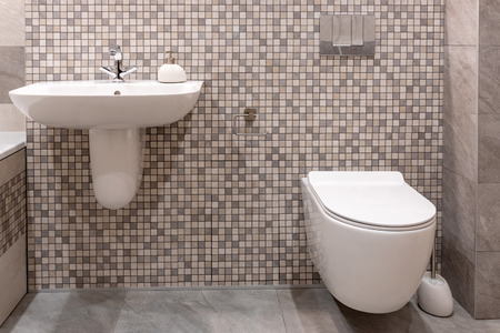 Sink and built-in toilet in modern bathroom. Stock Photo