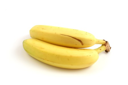 vitamines: two bananas isolated in studio close up
