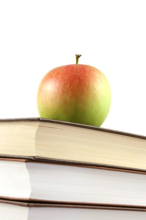 books pyramid with apple on top photo