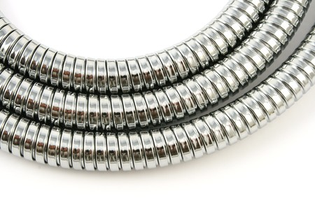 braided flexible: chromeplated shower pipe Stock Photo