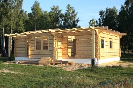 wooden home under construction photo