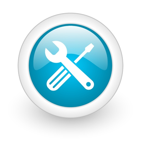 tools blue circle glossy web icon on white background  photo