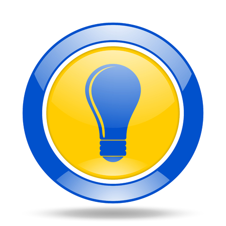 lighting button: bulb round glossy blue and yellow web icon Stock Photo