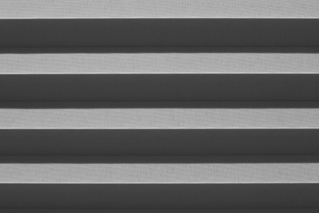 pleated: Window gray pleated blind close up with details in home interior. Structure and texture of fabric background. Stock Photo