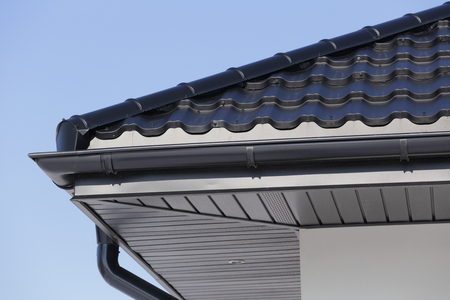Corner of the new modern house with gutter roof and wall.