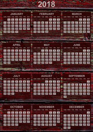 Calendar 2018 on wooden boards background.