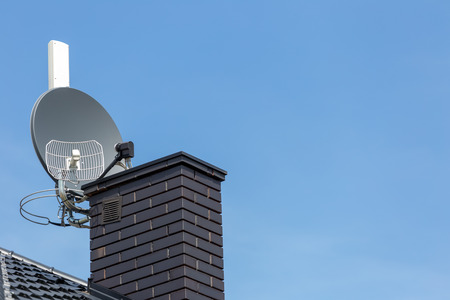 Satellite dish and tv, radio and wireless internet antenna with empty copy cpace