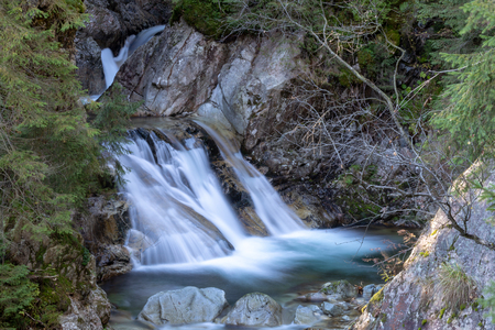 Beautiful waterfall Wodogrzmoty Mickiewicza in Polish Tatra mountains near Zakopane Im Poland. Mountain stream cascade long time exposure photography. Banco de Imagens