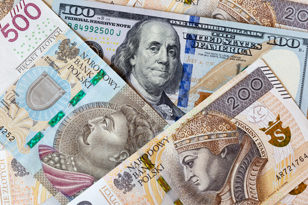 Close-up macro photography of dollar and polish zloty. Business money exchange concept background. Banco de Imagens
