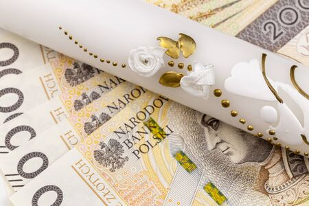 Baptism candle with money gift, polish currency zloty Stockfoto