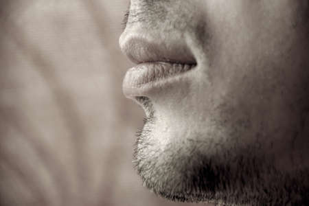 young unshaven: Closeup unshaven chin of a young man