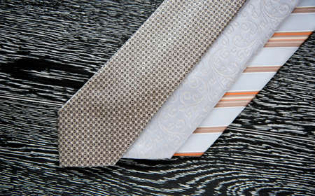 mens clothing: set of colorful mens ties on the background of boards