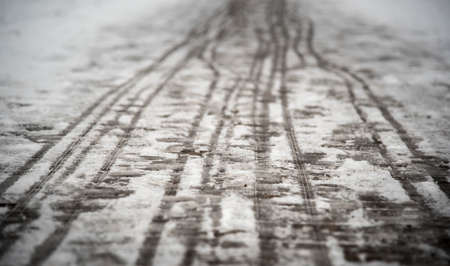 landowners: footprints on the snowy sidewalk, the first snow of the year Stock Photo