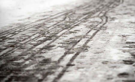 footprints on the snowy sidewalk, the first snow of the year Stock Photo