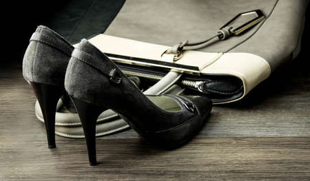 stilleto: Pair of female shoes and handbag isolated on a dark background
