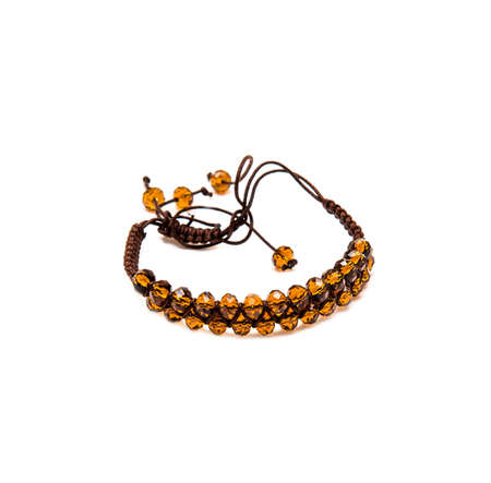 nicety: bracelet with orange beads isolated on white background
