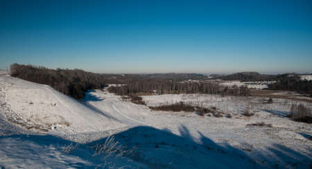 snowcovered: winter landscape of fields and snow-covered lake