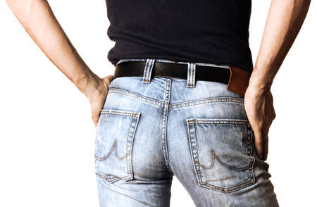Cropped image of a man in jeans closeup on white background Imagens