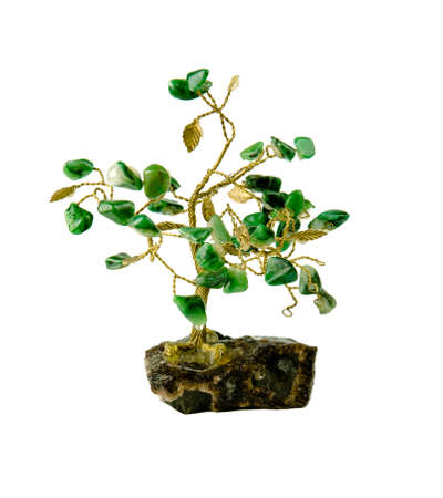 odd jobs: souvenir of a tree and colored green leaves of malachite stones isolated on white background