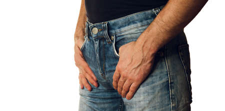 Cropped image of a man in jeans closeup on white background
