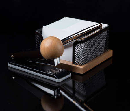 ball pens stationery: wooden stationery set with silver pen isolated on a dark background