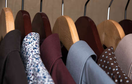 formal dressing: shirts and jackets in the wardrobe isolated closeup