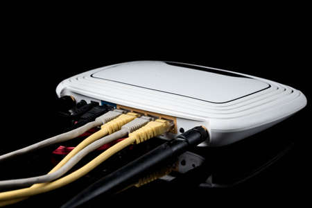 hidef: router with wires, cable, Internet, isolated on dark background Stock Photo