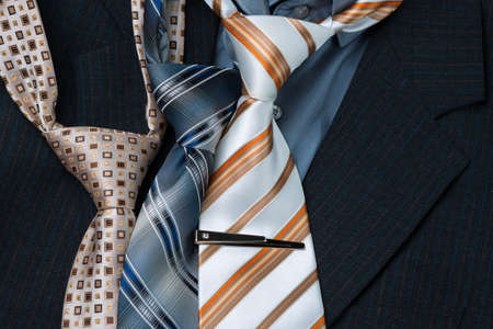 set of colorful mens ties isolated on the dark background Stock Photo