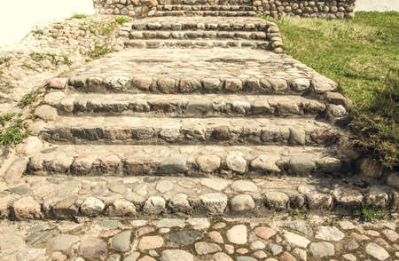 manora: old stone staircase in the background of green grass
