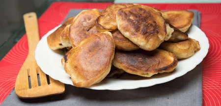 hiss: delicious homemade pancakes baking in the dark  pan Stock Photo