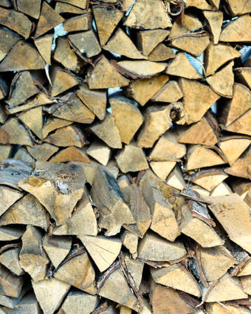 woodshed: background of many logs and timbers of a woodpile in the Woodshed
