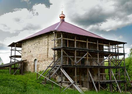 scaffolds: Pskov, Malsky monastery, the old stone Church